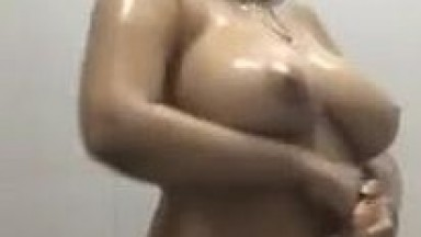 Young girl with big boobs pressing and taking shower